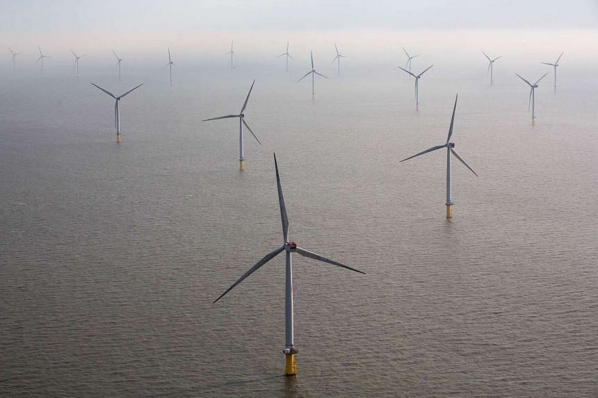 Wind turbines sit in the North Sea at the London Array offshore wind farm, a partnership between Dong Energy A/S, E.ON AG and Abu Dhabi-based Masdar, on Oct 27, 2015.