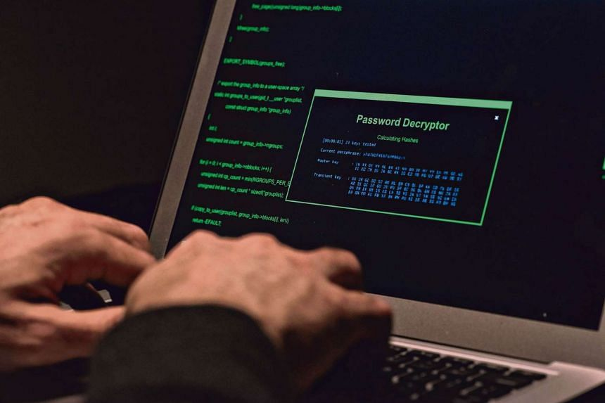 A man types on a laptop computer in an arranged photograph. A hacking group claims to offer cyber-weapons linked to US NSA in online auction.