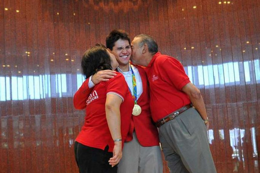Joseph Schooling with his parents at Parliament House on August 15.