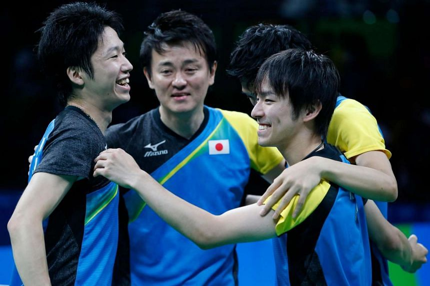 Team Japan celebrates after winning against Germany during Men's Team Semifinal 2 of the Rio 2016 Olympic Games.