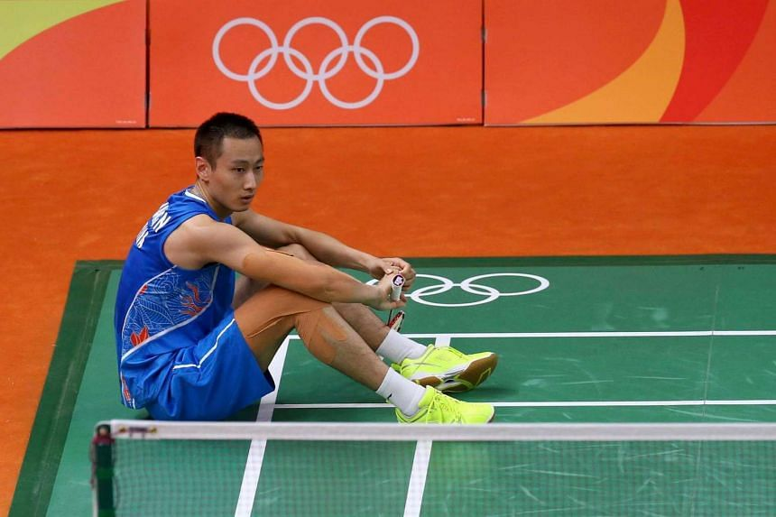 Zhang Nan of China sits on the court during his mixed doubles semi-final match against Indonesia.