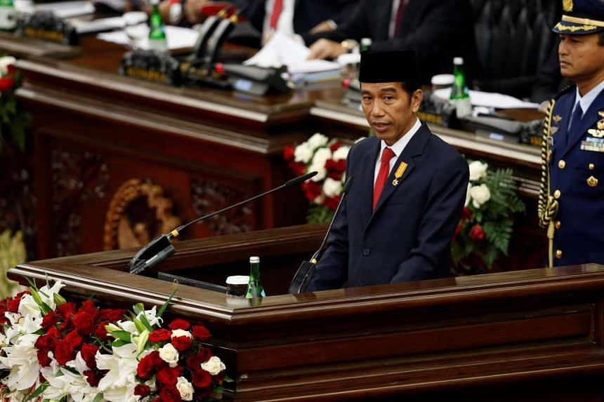 Indonesia's President Joko Widodo delivers a speech in front of parliament members at the House of Representative building in Jakarta, Indonesia, August 16.