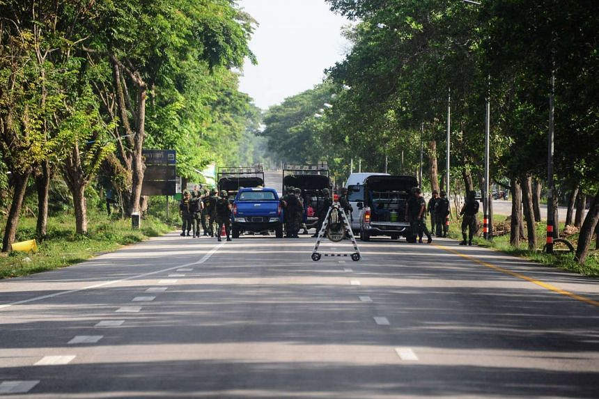 Thai soldiers cordon off the scene of an attack following two roadside bomb blasts at four separate locations by suspected separatist militants in the Bacho district of Narathiwat on Aug 15, 2016.