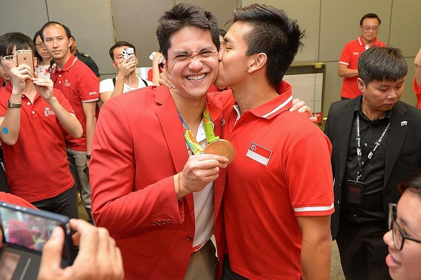 Schooling and his father, reunited after months apart, embracing each other at the airport. Mr Colin Schooling did not travel to Rio de Janeiro because of health concerns.