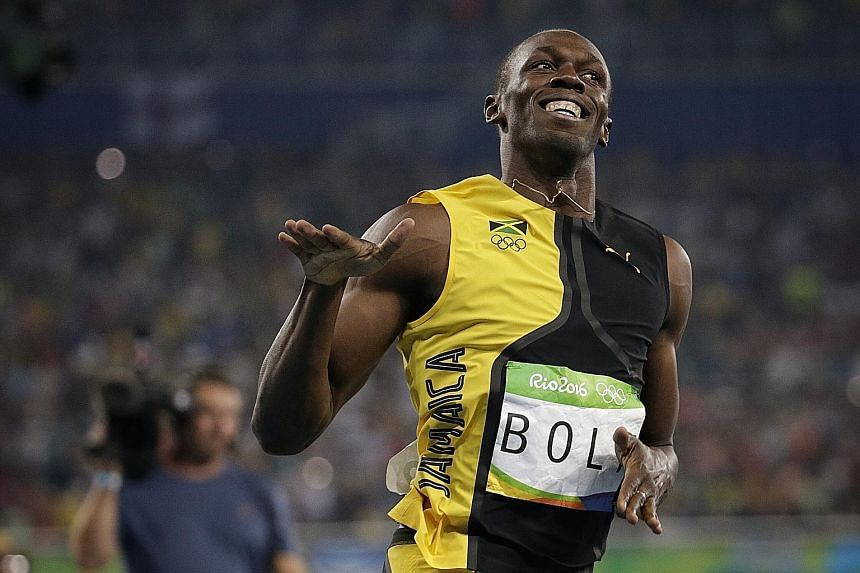 "Usain Bolt celebrating his 100m victory at Rio's Olympic Stadium. The Jamaican ran 9.81sec in his ""weakest event"" to set his sights on retaining his next, the 200m."