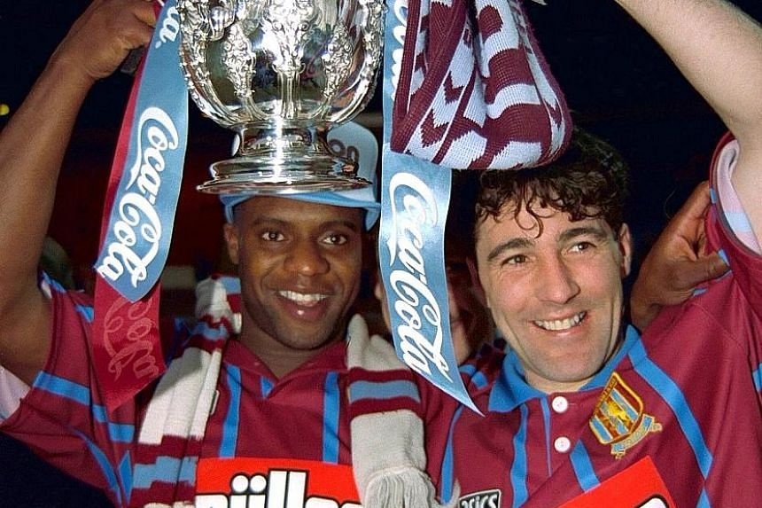 Aston Villa's Dalian Atkinson (left) and Dean Saunders celebrating their English League Cup win over Manchester United in 1994.