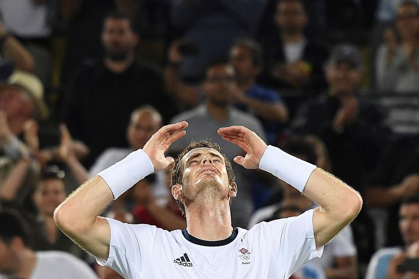 Britain's Andy Murray succumbs to emotion after becoming the first man to successfully defend his Olympic title. He outlasted Argentina's Juan Martin del Potro in four sets in Sunday's final.