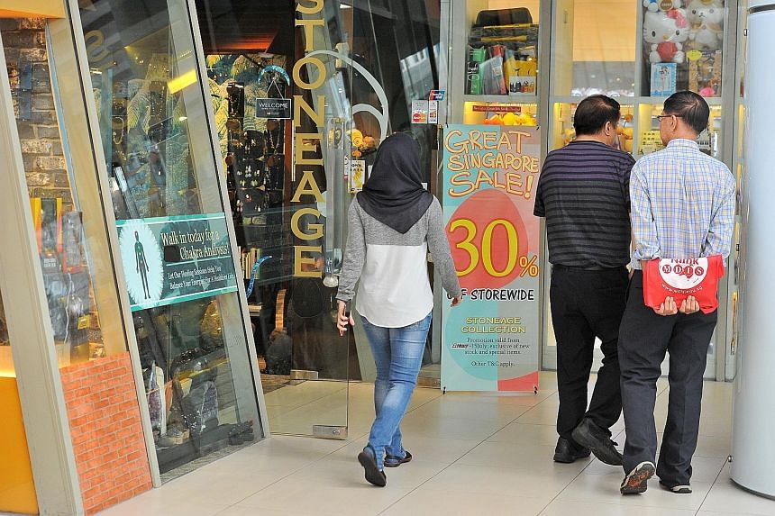 A storefront at Marina Square offering discounts for the Great Singapore Sale, which ended its extended run on Sunday. Economists expected a 2 per cent rise in sales, but there was only a 0.9 per cent increase, much of which came from higher car sale