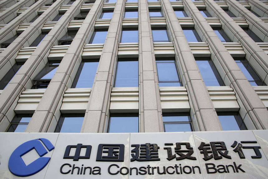 A sign of China Construction Bank is seen at a branch in Beijing, China, on April 21.