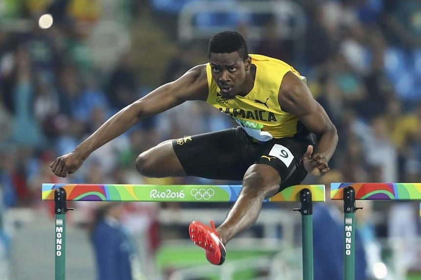 Jamaica's Deuce Carter competes in the Men's 110m Hurdles Round 1, on August 15.