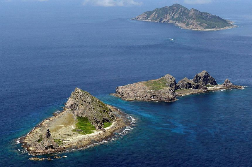 A group of disputed islands, known as Senkaku in Japan and Diaoyu in China is seen in the East China Sea, in this photo taken in September 2012.