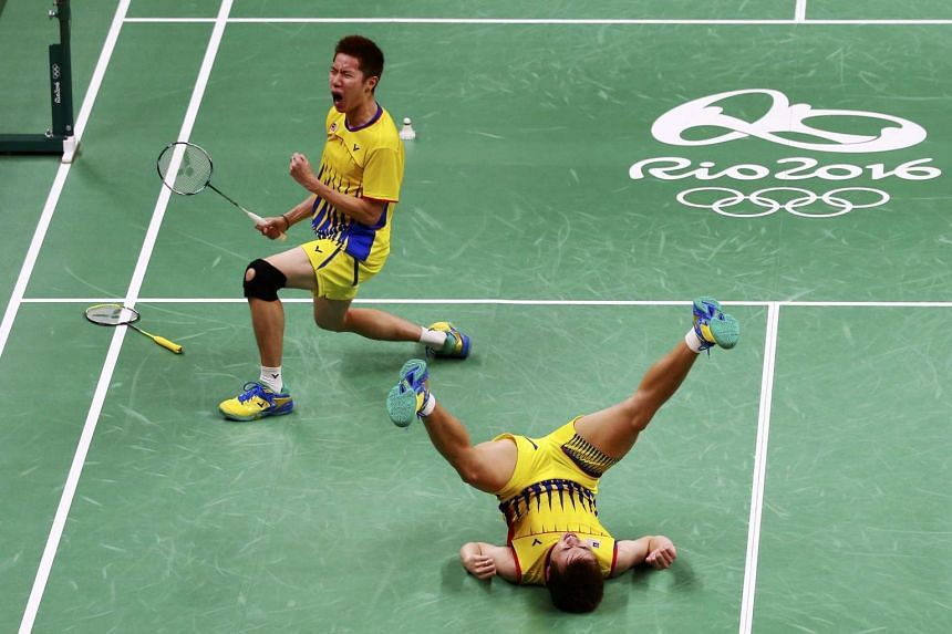 Malaysia's Goh V Shem (top) and Tan Wee Kiong celebrating after defeating China's Chai Biao and Hong Wei in the men's badminton doubles semi-final, in Rio de Janeiro on Aug 16, 2016.