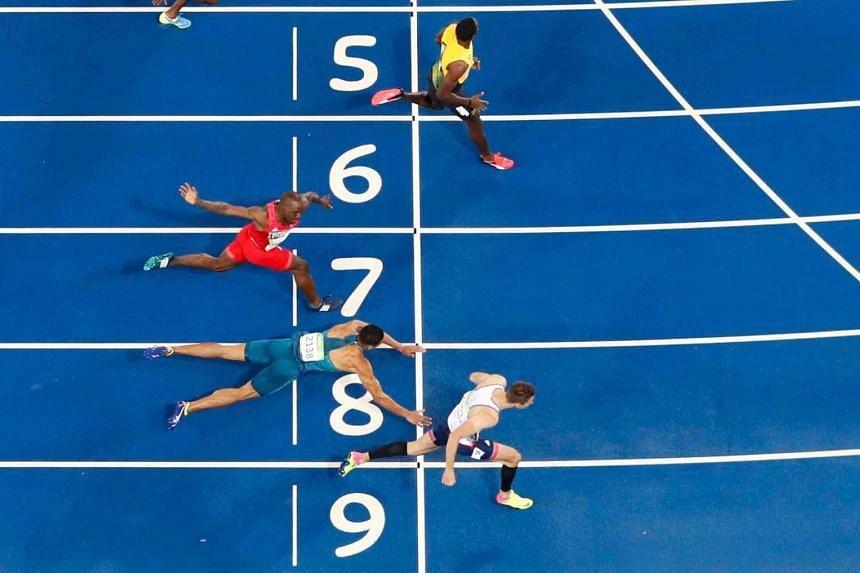 Joao Vitor De Oliveira of Brazil falls across the finish line during the men's 110m Hurdles heats.