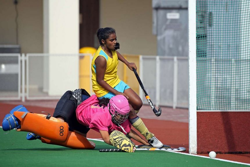 Crescent Girls' School's Shaalini Subramaniam (in yellow) scores during the penalty shootout to beat CHIJ St Nicholas Girls' School in the C Division girls hockey finals held on Aug 16, 2016.