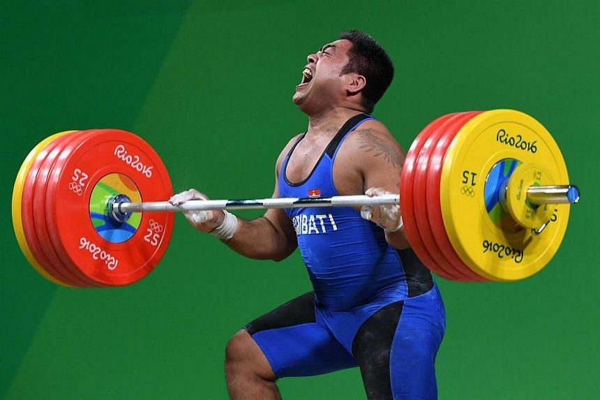 David Katoatau reacts while competing during the Men's 105kg weightlifting competition at the Rio 2016 Olympic Games on August 15.
