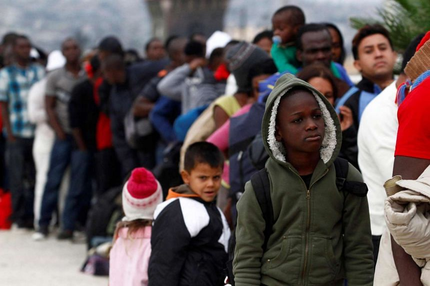 Haitians migrants line up as they make their way to the US to seek asylum at the San Ysidro Port of Entry in Tijuana, Mexico, July 16.