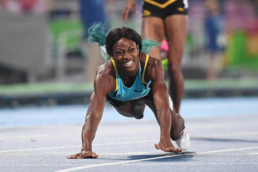 Bahamas' Shaunae Miller crosses the finish line to win the Women's 400m final.