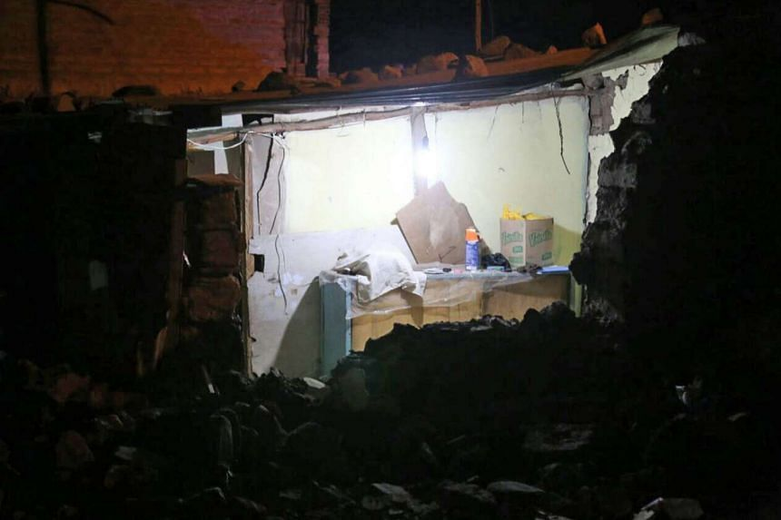 A handout picture provided by the Agencia Estatal Andina shows the inside of a damaged house after an earthquake in Arequipa, Peru. At least 9 people have died and 30 were injured after a 5.2 magnitude earthquake late on August 14 in the province of