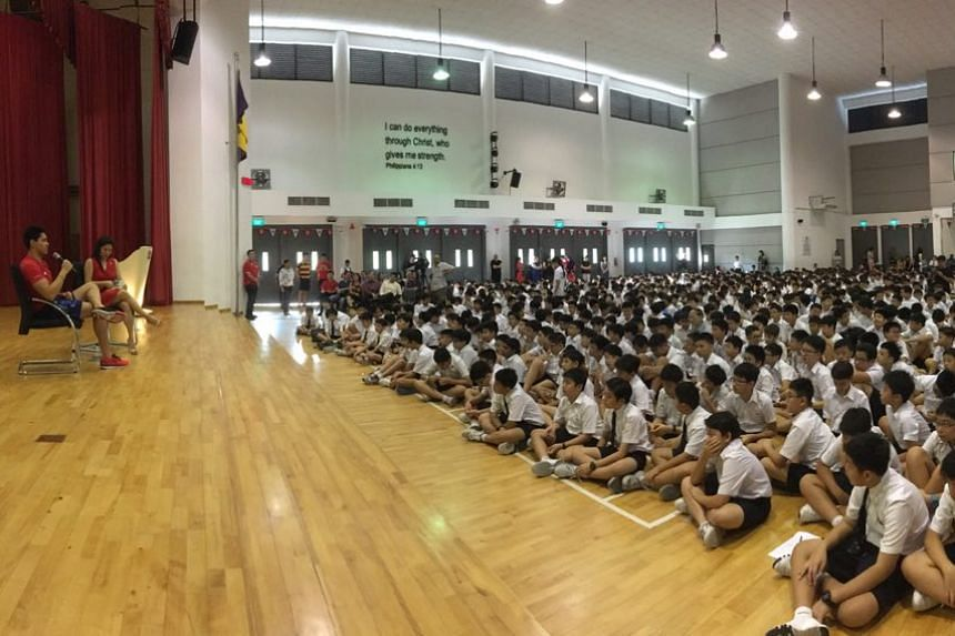 Joseph Schooling interacts with students during the morning assembly.