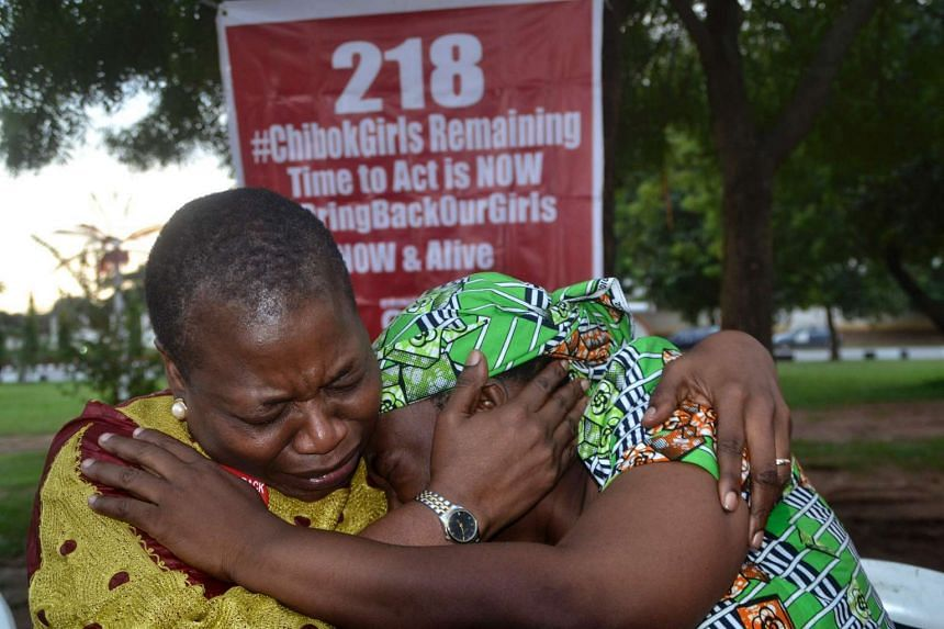 The coordinator of Bring Back our Girls, Prof. Obby Ezekwesili (left), cries while trying to console Esther Yakubu, the mother of Dorcas Yakubu (not pictured), the girl that appeared in a video released by Boko Haram.