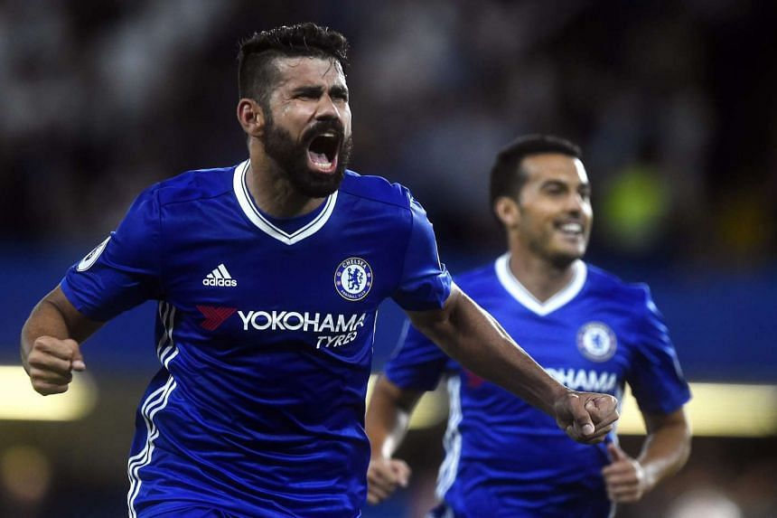 Chelsea's Diego Costa (left) celebrates with teammate Pedro after scoring against West Ham United.