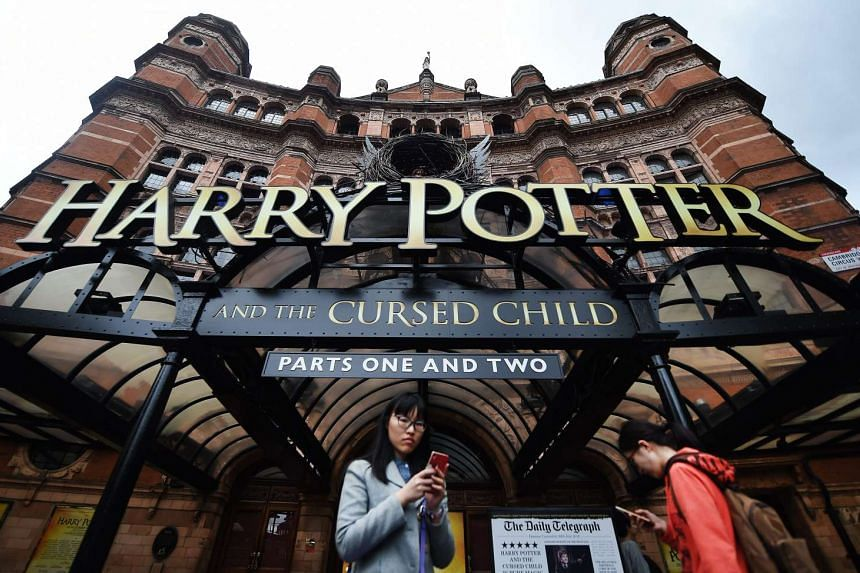 Fans use mobile phones outside the Palace Theatre in London, where  Harry Potter and the Cursed Child is being staged.