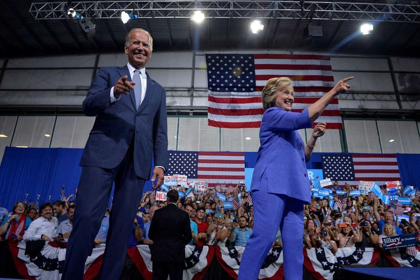 Democratic presidential candidate Hillary Clinton and Vice-President Joe Biden campaign together in Scranton, Pennsylvania on Monday (Aug 15).
