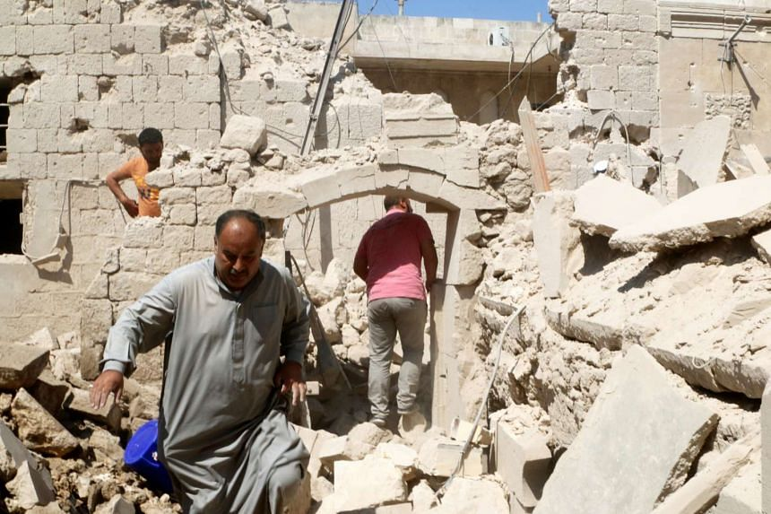 Residents inspect their damaged homes after an airstrike on the rebel-held Old Aleppo, Syria on Monday (Aug 15).