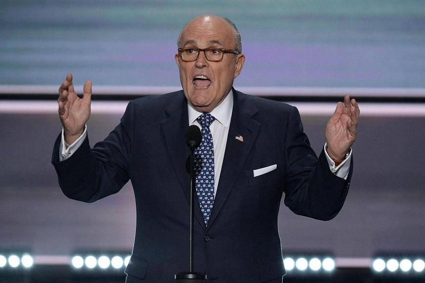 Rudy Giuliani, former mayor of New York, addresses delegates on the first day of the Republican National Convention on July 18, 2016 at Quicken Loans Arena in Cleveland, Ohio.