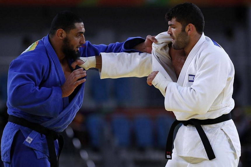 Islam El Shehaby of Egypt (left) and Or Sasson of Israel in action in the men's +100kg bout of the Rio 2016 Olympic Games Judo events.