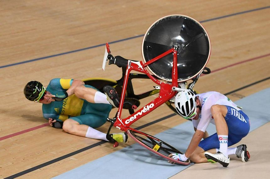 Australia's Glenn O'Shea and Italy's Elia Viviani crash during the Men's Omnium Points race track cycling event.
