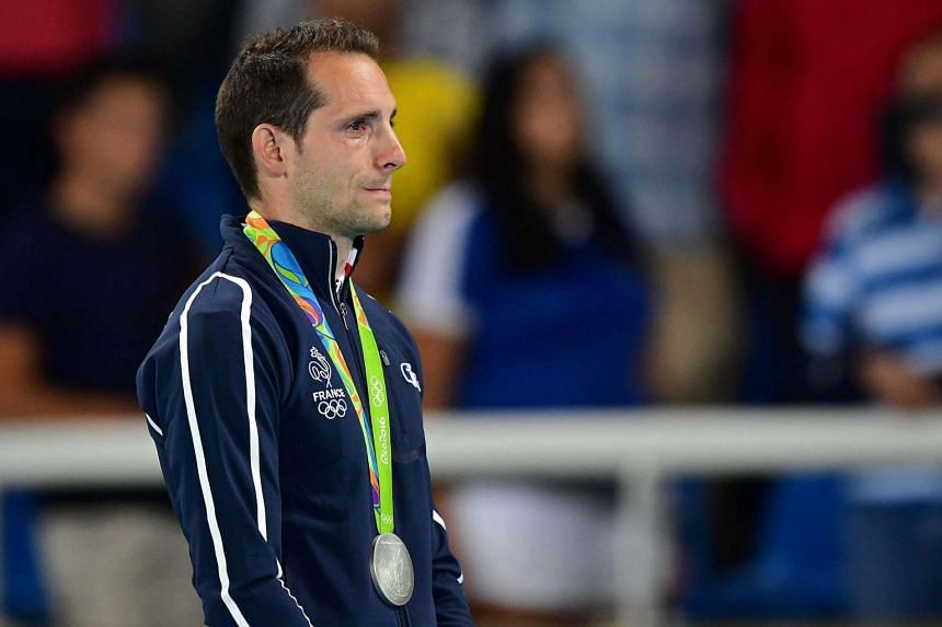 Silver medallist France's Renaud Lavillenie cries on the podium during the medal ceremony for the men's pole vault.