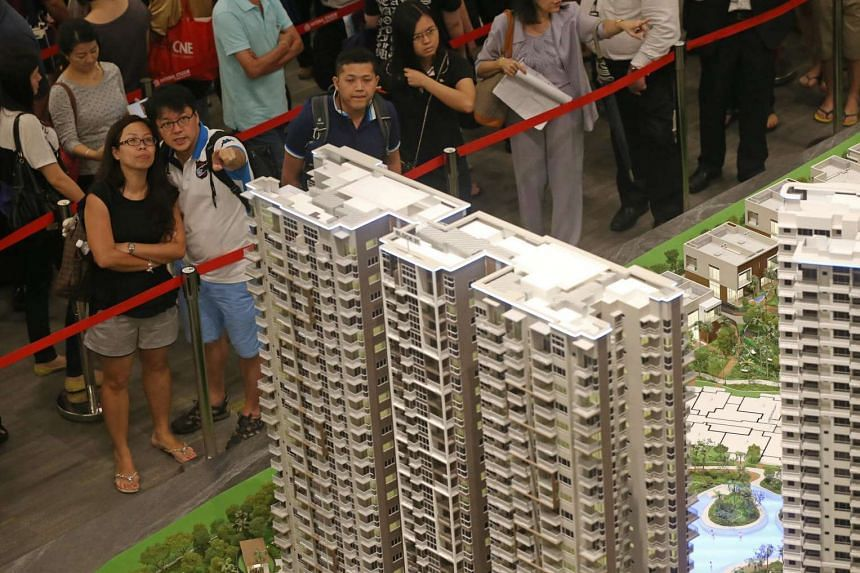 Buyers queuing with their agents to book a unit after getting a ticket in a ballot process for High Park Residences, a condo development in Fernvale in 2015.