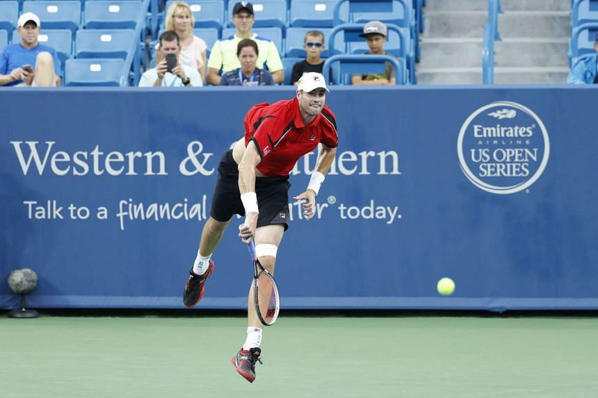 United States' John Isner serves to Italian Fabio Fognini on Day 4 of the Western & Southern Open on Aug 16, 2016.