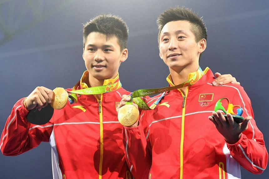 Synchronised divers Chen Aisen (left) and Lin Yue (right) won gold for China in the 10m platform final.