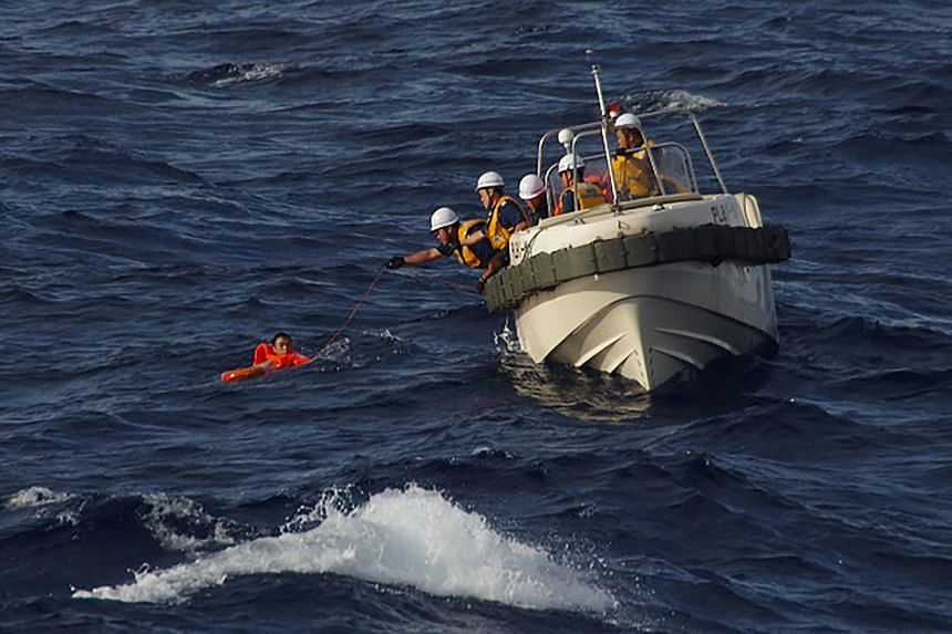 Japanese coast guards rescuing a crew member of a Chinese fishing boat near the waters of disputed East China Sea islands on August 11.