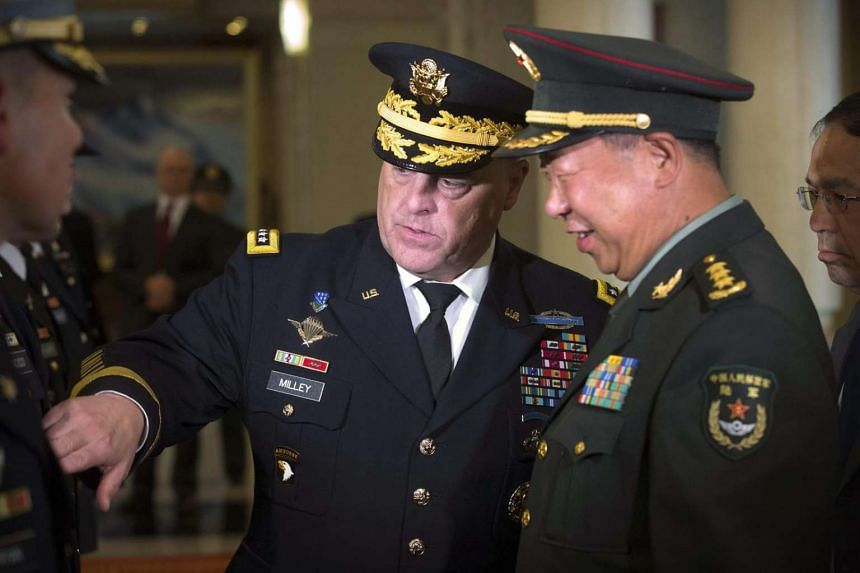 US Army Chief of Staff General Mark Milley (left) introduces members of his staff to China's People's Liberation Army (PLA) General Li Zuocheng (right) during a welcome ceremony at the Bayi Building in Beijing on August 16.