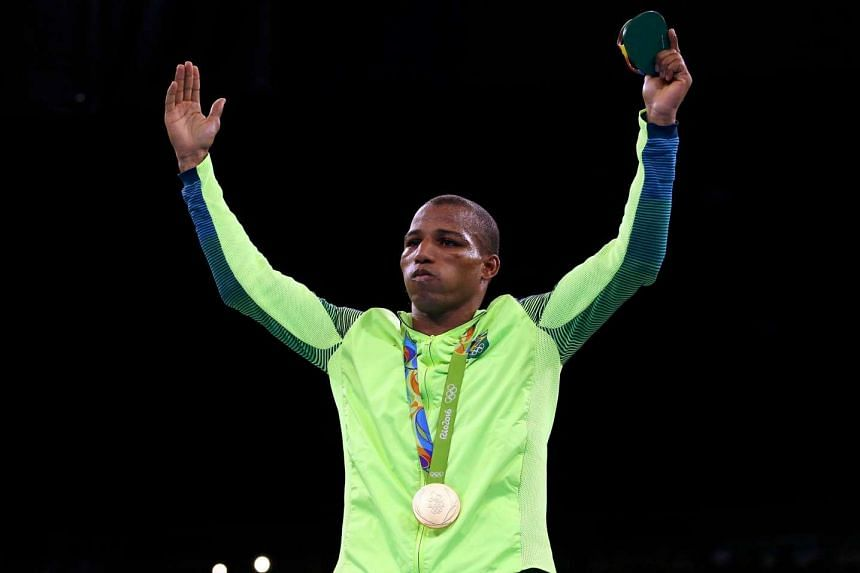 Gold medalist Robson Conceicao of Brazil poses with his medal on August 16.