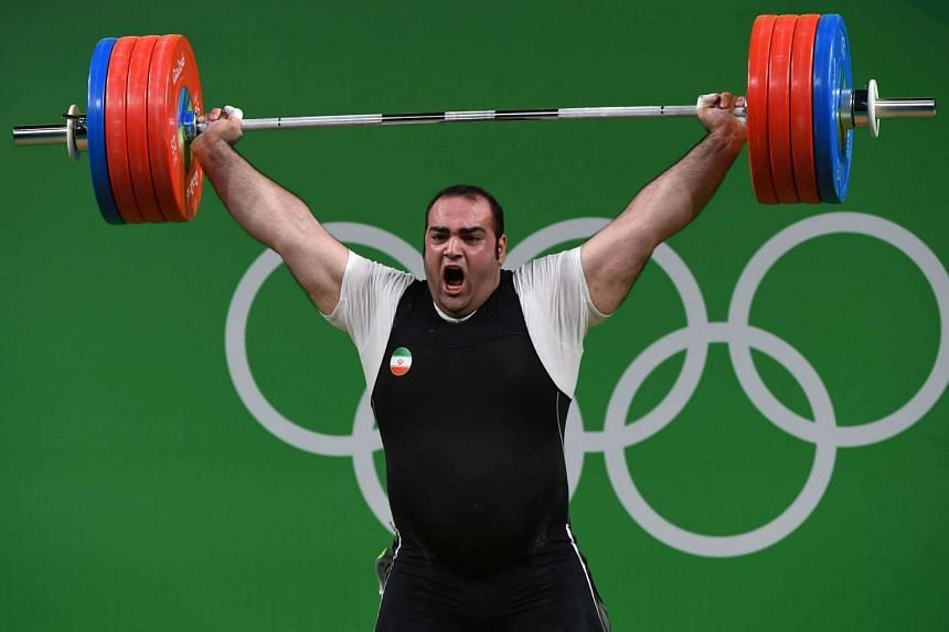 Iran's Behdad Salimikordasiabi competes during the Men's +105kg weightlifting competition at the Rio 2016 Olympic Games in Rio de Janeiro on August 16.