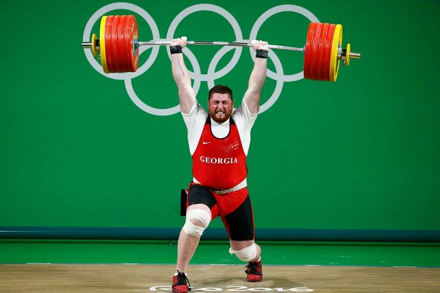 Lasha Talakhadze of Georgia sets a World Record during the men's +105kg competition of the Rio 2016 Olympic Games Weightlifting events on August 16.