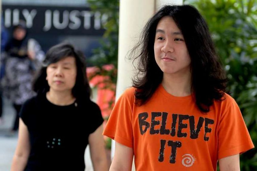 Mary Toh Ai Buay (left), mother of Teen blogger Amos Yee Pang Sang, arrives at the State Courts on August 17.