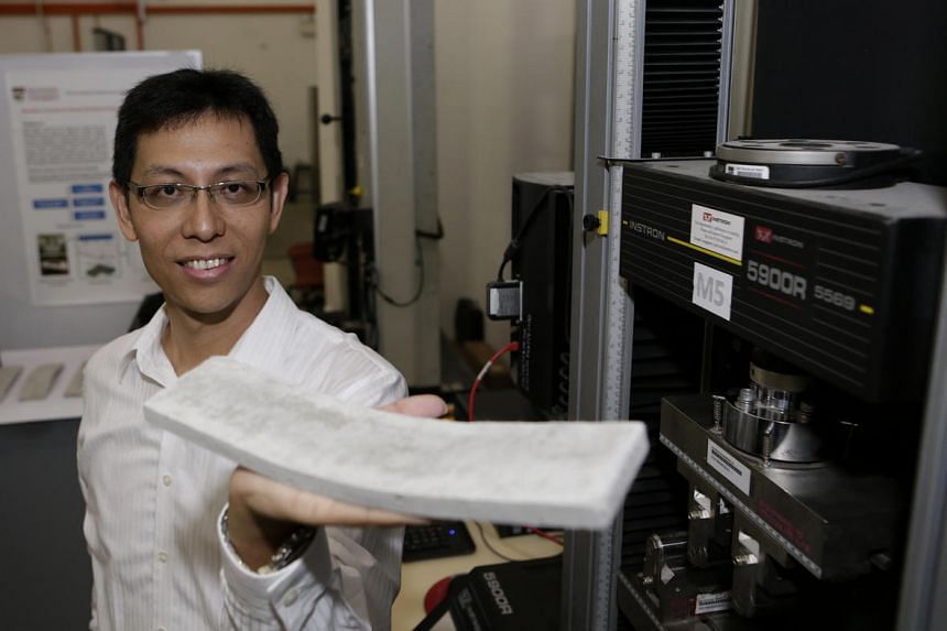 Prof Yang En-Hua, with the bent ConFlexPave concrete slab after the bending test.