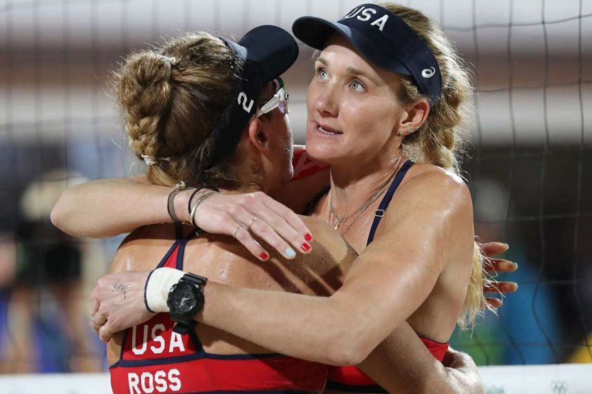 USA's Kerri Walsh Jennings (second from left) and USA's April Ross (far left) react as Brazil's Agatha Bednarczuk (second from right) and Brazil's Barbara Seixas De Freitas (far right) celebrate after winning the women's beach volleyball semi-final m