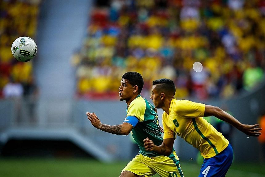 South Africa's Keagan Dolly (left) in action against Brazil's Marquinhos in an Olympic match in Brasilia this month.