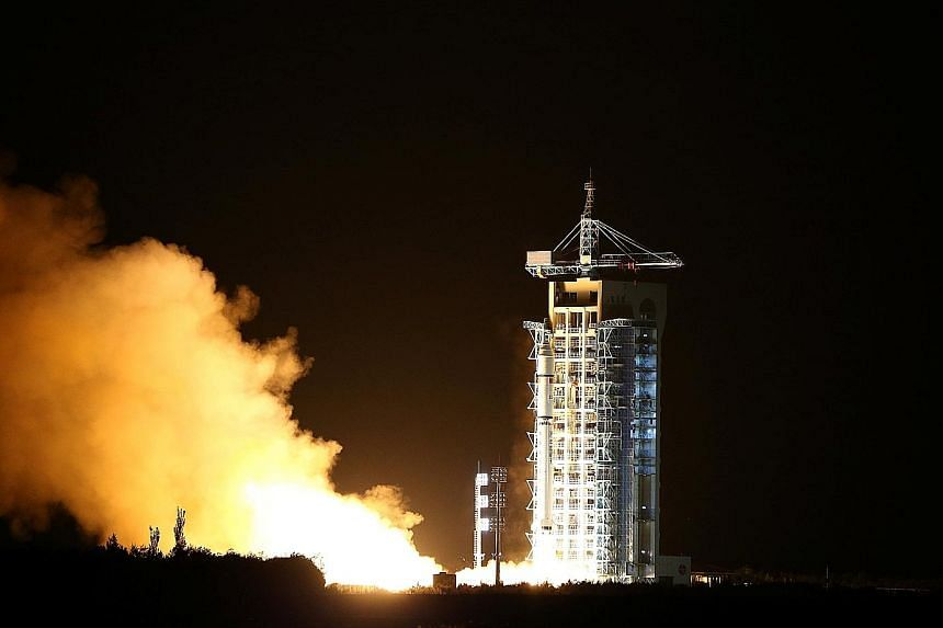 The world's first quantum satellite being launched in Jiuquan, Gansu province, yesterday.