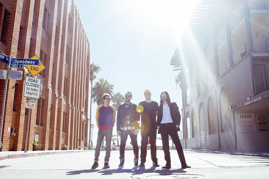 Weezer's (from left) Rivers Cuomo, Scott Shriner, Patrick Wilson and Brian Bell performed feel-good and bittersweet anthems at their concert on Monday.