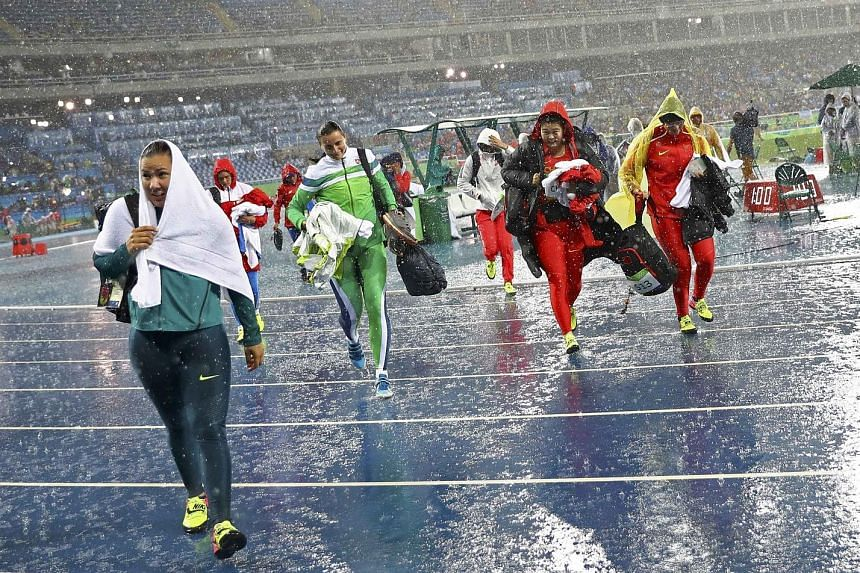 When it rains, it pours in Rio, as discus throwers were forced to leave the field when torrential rain put a halt to proceedings. Sandra Perkovic of Croatia later flung 69.21m in the final to win gold, in drier conditions.