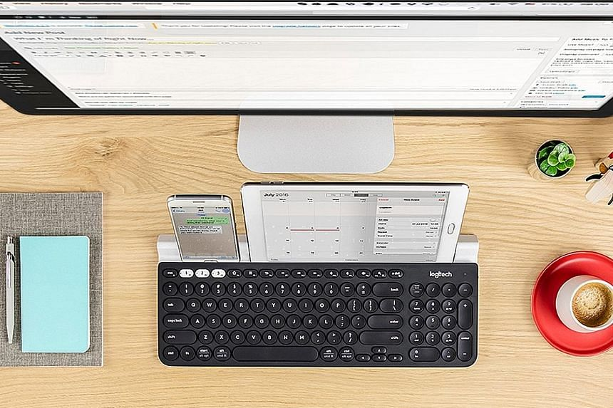 The Logitech K780 can connect up to three devices using both Bluetooth and the USB adapter at the same time.