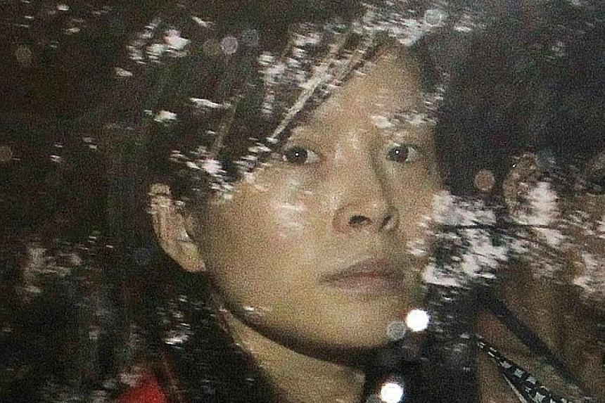 Jiang (left) is accused of slashing and stabbing Ms Zhao (above) in a Geylang flat in 2013. The attack left Ms Zhao with a gash across her left cheek that cut a major facial artery, a gash across the back of her head that shaved off a part of her sku