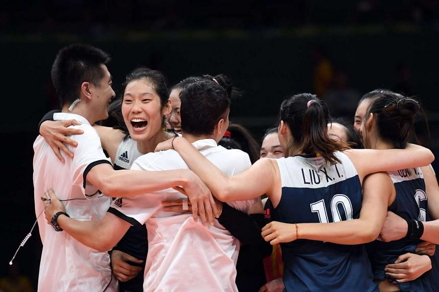 China's women's volleyball team celebrating after defeating Brazil in their quarter-final match at the Maracanazinho stadium in Rio de Janeiro on Aug 16, 2016.
